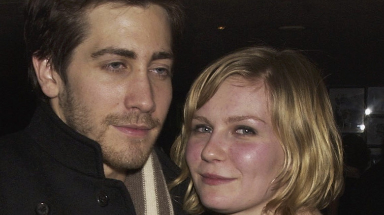 Jake Gyllenhaal and Kirsten Dunst attend a premiere party in 2003