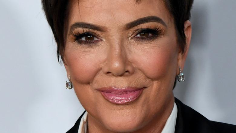 Kris Jenner grinning with diamond earrings