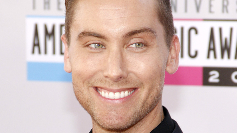 Lance Bass smiling at an event in L.A.