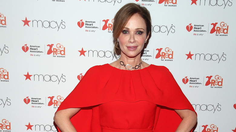 Former NCIS star Lauren Holly poses on the red carpet