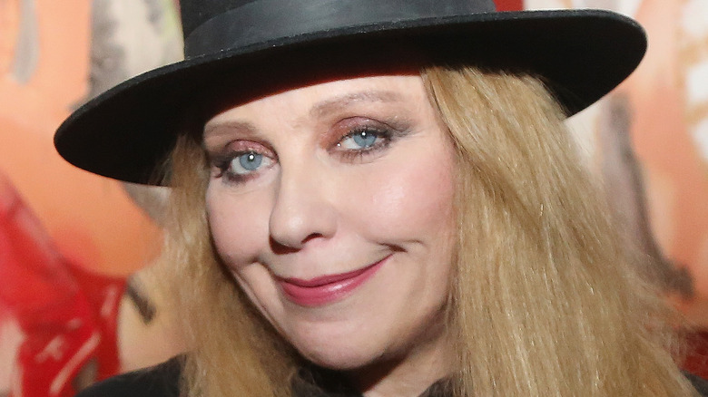 Bebe Buell smiles with her mouth closed