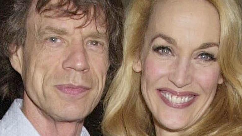 Mick Jagger smiles alongside Jerry Hall