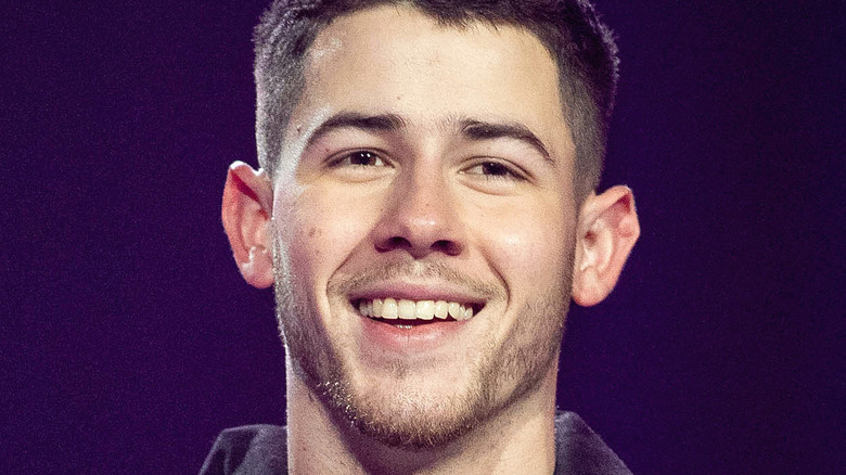 Nick Jonas smiles