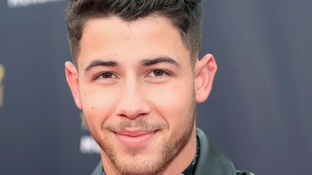 Nick Jonas grinning