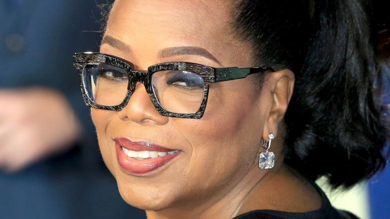 Oprah Winfrey smiling over her shoulder