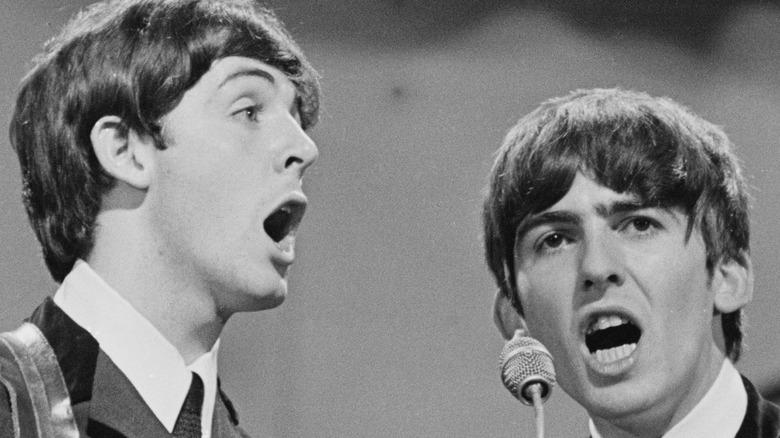 Vintage photo of George Harrison and Paul McCartney performing