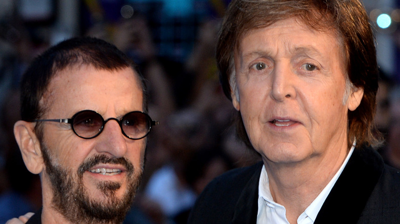 Ringo Starr and Paul McCartney pose for photographers