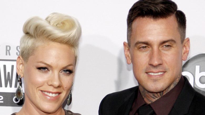 Pink and Carey Hart posing