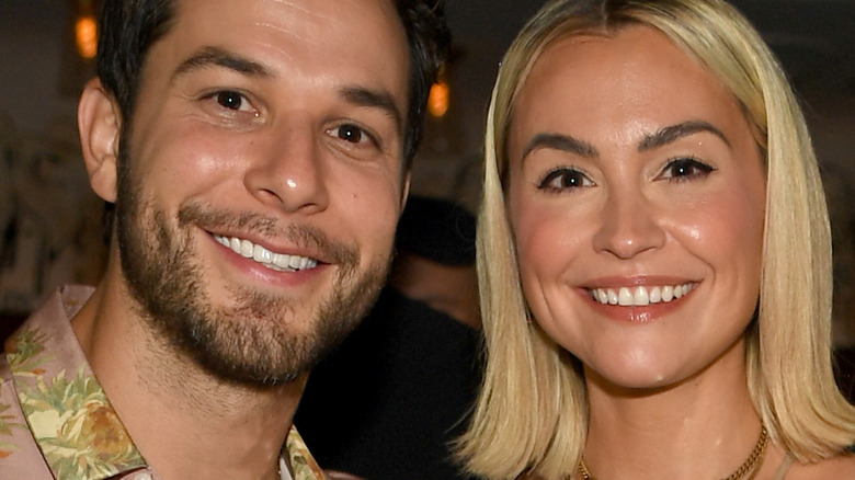 Skylar Astin and Lisa Stelly at event