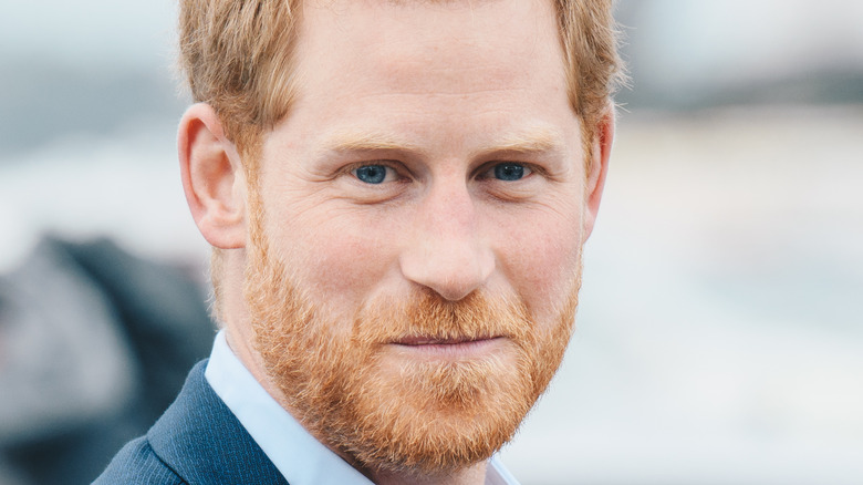 Prince Harry grinning with facial hair
