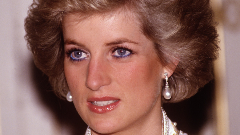Princess Diana wears pearl earrings