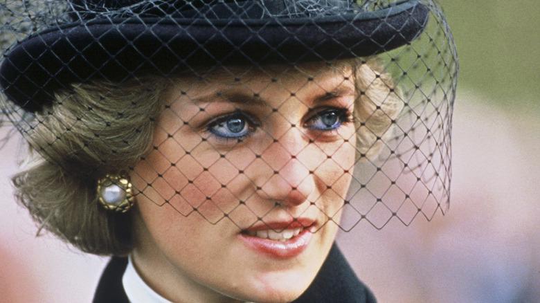 Princess Diana wearing black hat