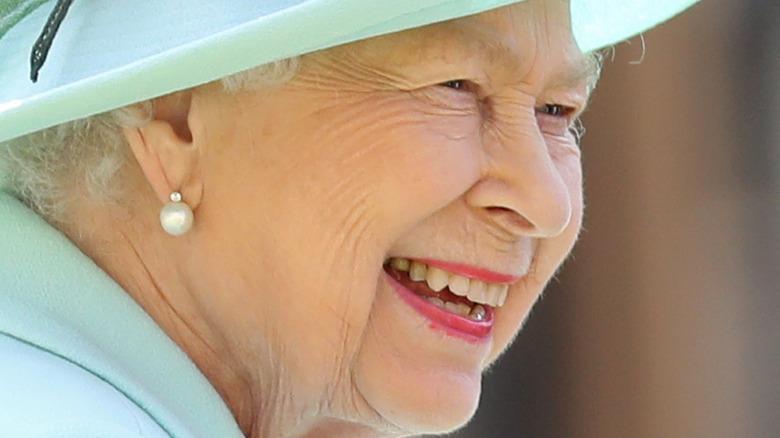 Queen Elizabeth smiling in profile