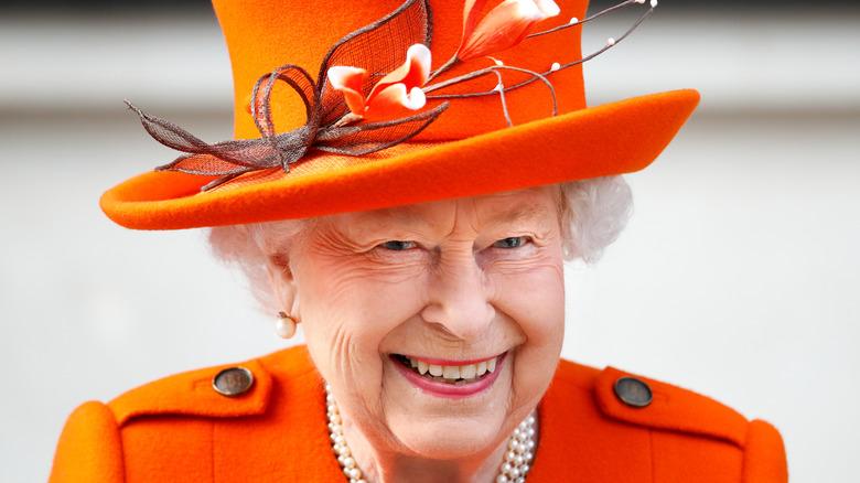 Queen Elizabeth in orange hat