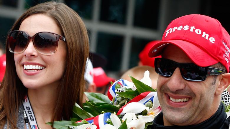 Tony Kanaan and wife Lauren at a race