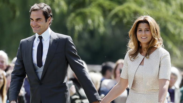 Roger and Mirka Federer walking