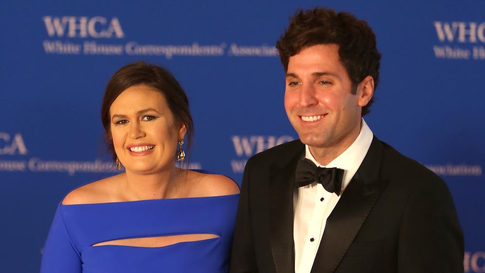 Sarah Huckabee Sanders and husband Bryan Sanders smiling on the red carpet