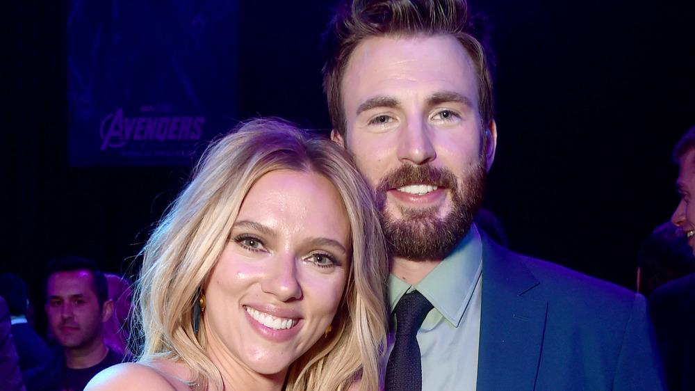 Scarlett Johansson and Chris Evans standing together