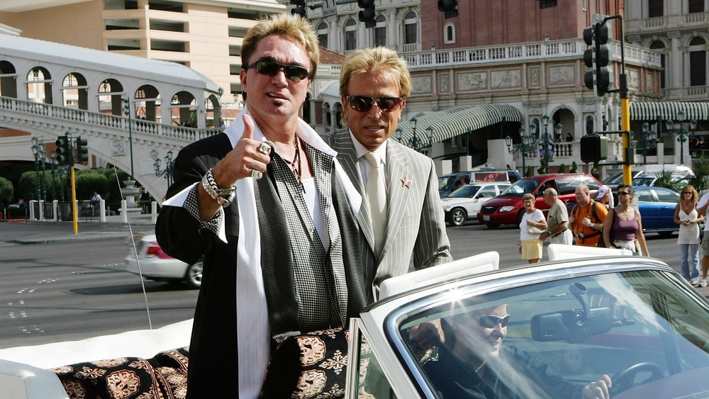 Siegfried and Roy in a convertible