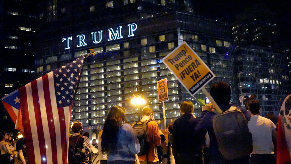 People rallying outside Trump hotel