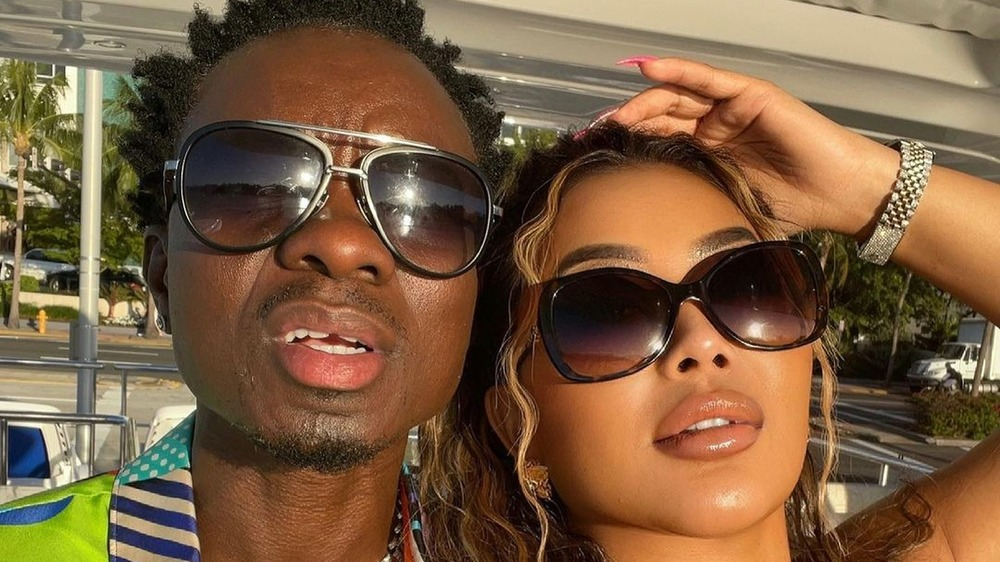 Michael Blackson and Rada take a selfie together with sunglasses