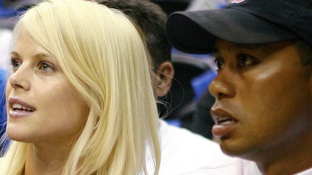 Tiger Woods sitting next to Elin Nordegren