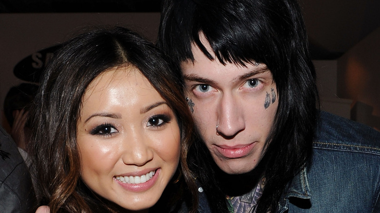 Brenda Song posing with Trace Cyrus