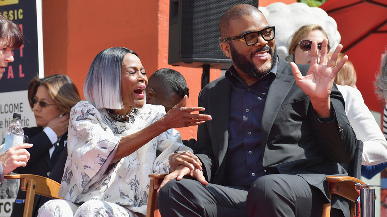Perry laughing with Cicely Tyson