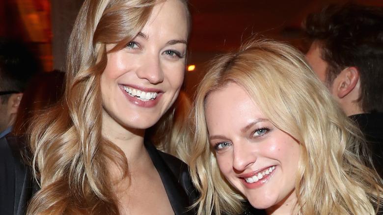 Yvonne Strahovski and Elisabeth Moss smiling