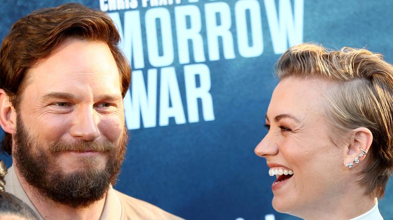 Chris Pratt and Yvonne Strahovksi laugh together on the red carpet