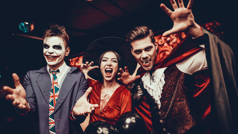 Group of young adults in Halloween costumes