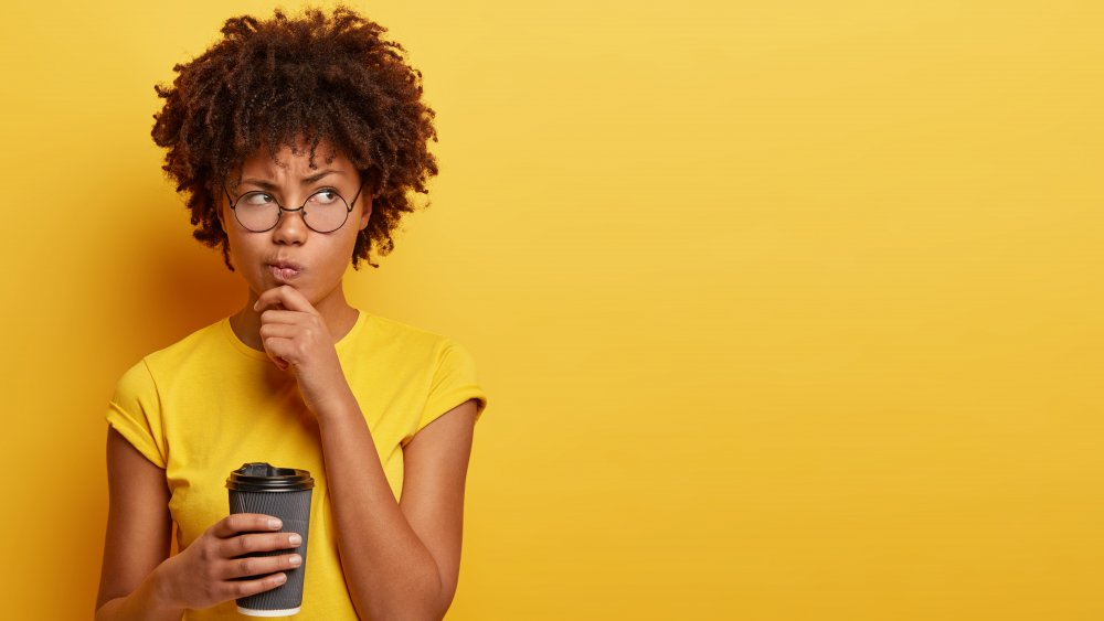 Woman contemplating coffee
