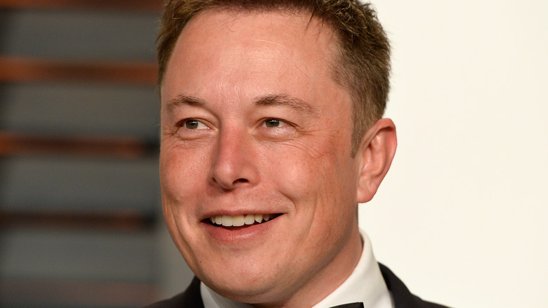 Elon Musk smiling at formal event