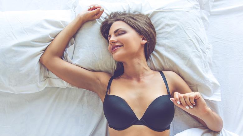 Woman sleeping in bra