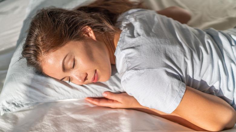 Woman sleeping on stomach