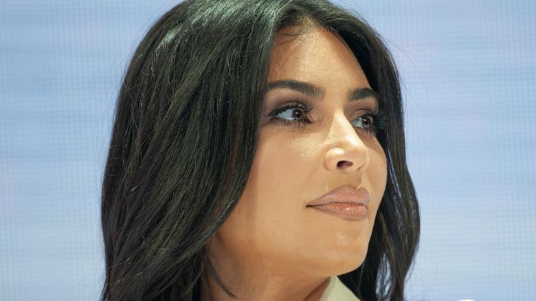 Kim Kardashian wears a white suit.