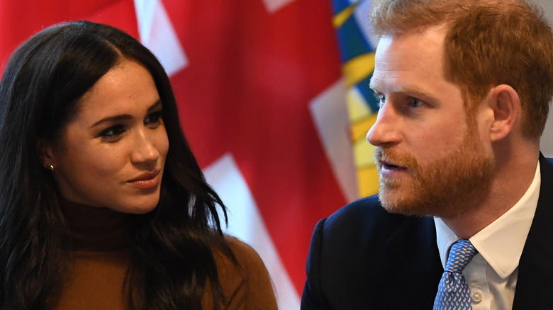 Prince Harry, Duke of Sussex and Meghan, Duchess of Sussex gesture during their visit to Canada House