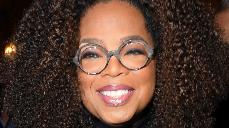Oprah smiles at an event.