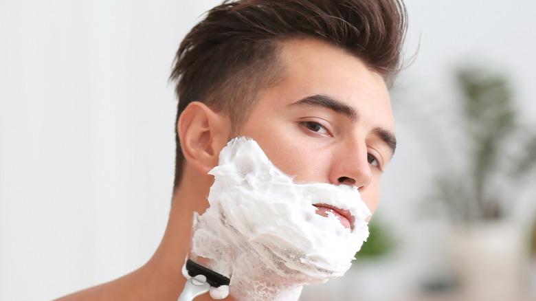 A man shaving his face