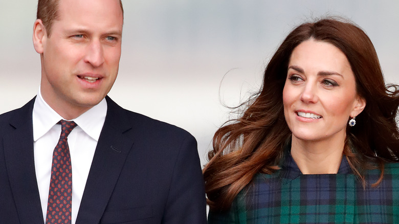 Prince William and Kate Middleton hold hands.