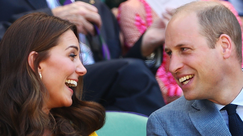 Kate Middleton and Prince William smile at each other.