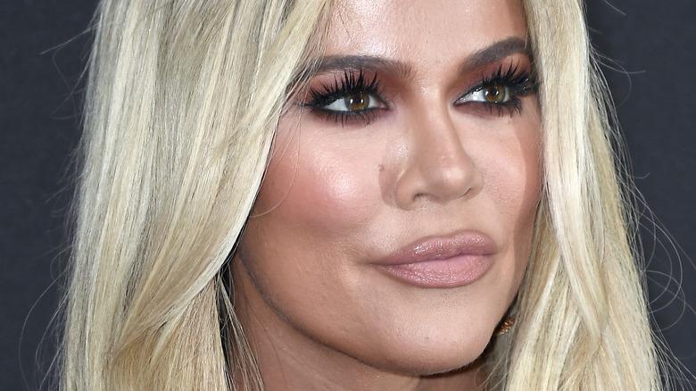 Khloe Kardashian poses at an event.