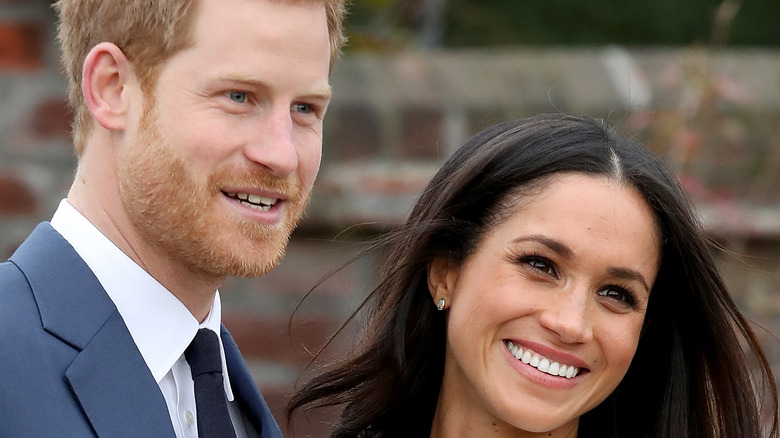 Meghan Markle and Prince Harry smile