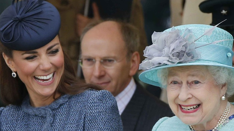 Queen Elizabeth and Kate Middleton laughing