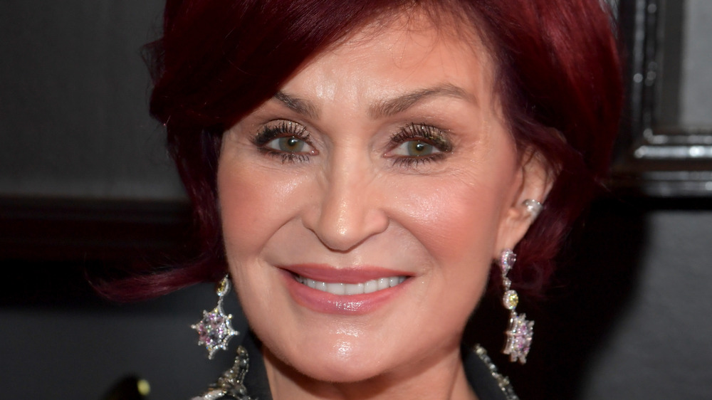 Sharon Osbourne glimmering earrings