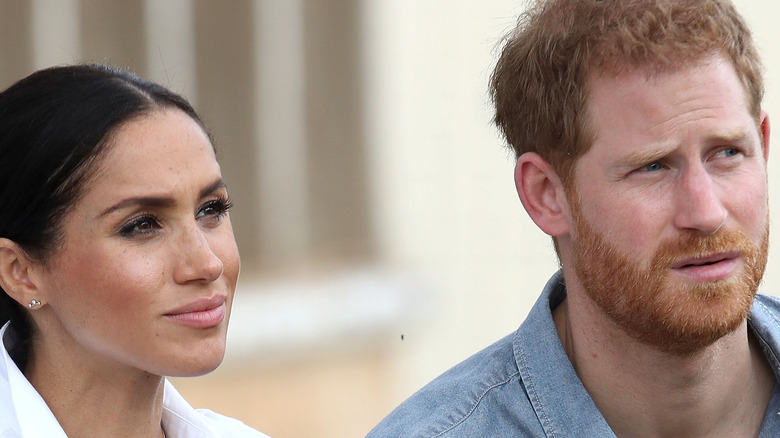 Prince Harry and Meghan Markle squinting