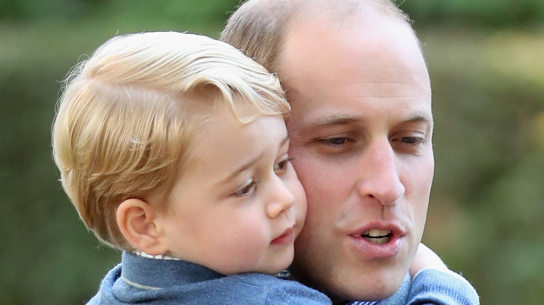 Prince George and Prince William at an event