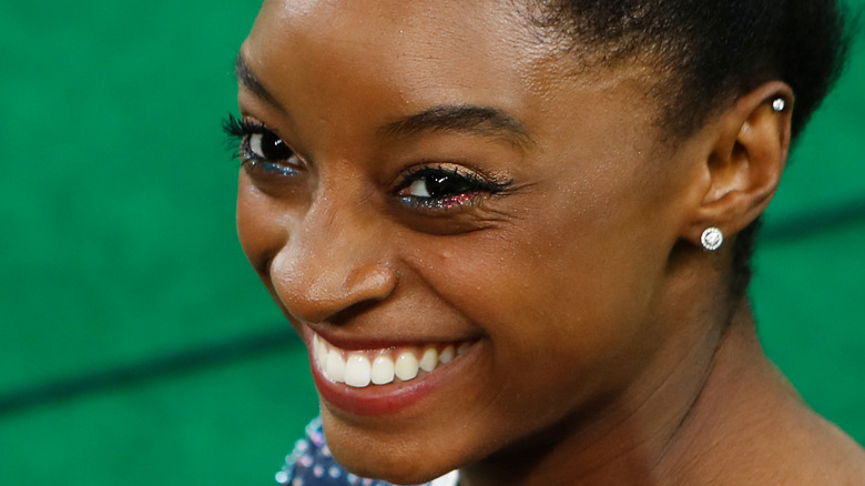 Simone Biles smiling at competition