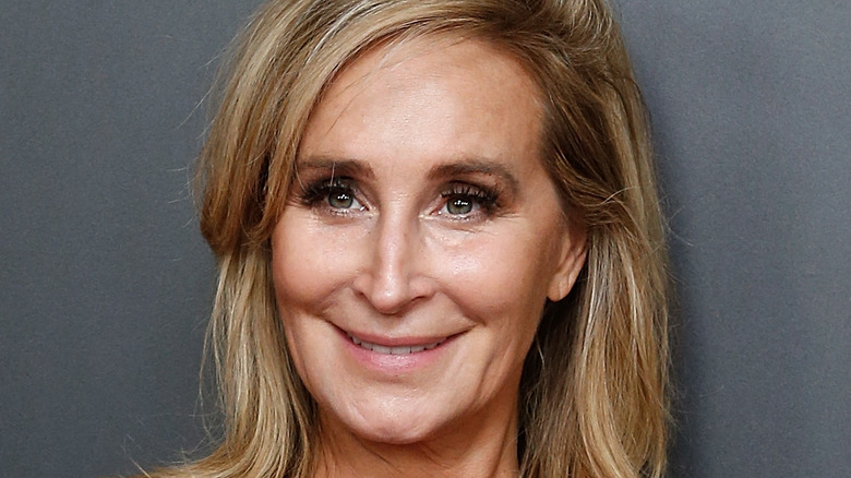 Sonja Morgan smiles with her hair down.
