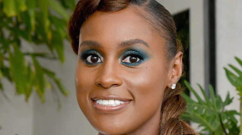 Issa Rae smiles on the red carpet
